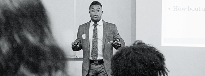 Photograph of a man giving a presentation.