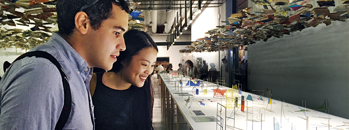 Nathaniel Ezolino '17 (left) and Ashley Guo '18 (right) looking at an art exhibit.