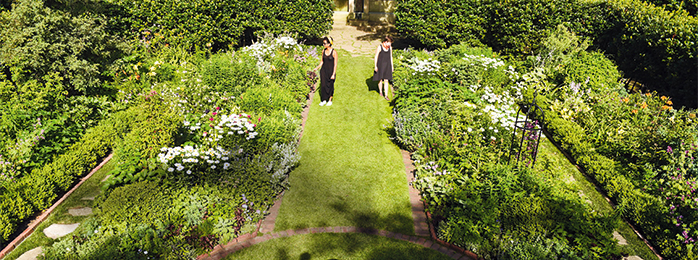 two women standing in the Shakespeare garden