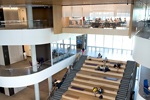 "The hanging classroom:  Suspended high above the Collaboration Plaza is the department's ""hanging classroom."" Sunlight filters into both sides of the room, which overlooks the building's soaring  main atrium."