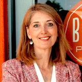 Elise Wetzel standing in front of a Blaze Pizza sign
