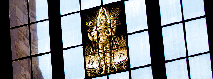 Stained glass window with an image of Vishnu.