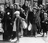 Picture of Holocaust with people huddled in a line