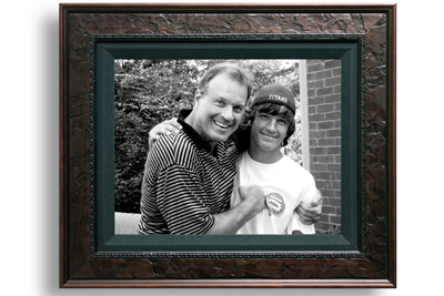 A picture frame with John and his son Will smiling together