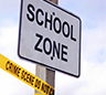 Sign saying School Zone with yellow tape on the bottom