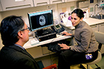 Taking aim at glioblastoma: A promising new SNA drug offers new hope in the fight against this notoriously aggressive brain cancer. Developed by Mirkin and Feinberg professor Alexander Stegh (left), it diminishes the ability of glioblastoma cells to divide. It is now undergoing human clinical trials, led by Priya Kumthekar, MD (right).