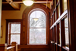 Light streams through a Palladian window on the second floor, one of many sources of natural light in a building designed to foster reading and study.