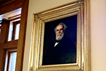 A portrait of commodities trader and philanthropist Orrington Lunt (1815–1897), one of the founders of Northwestern, overlooks the second-floor stairs. Lunt provided $50,000 (nearly $1.5 million in today's dollars) toward the cost of the $100,000 building.